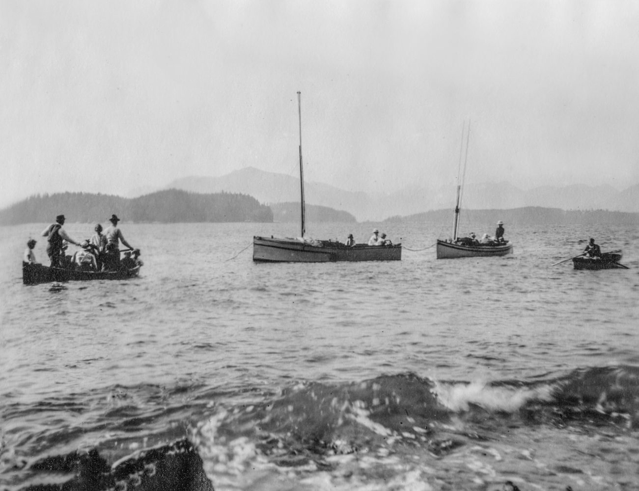 #1 - Boats for a picnic arriving at Brady's Beach, 1919
